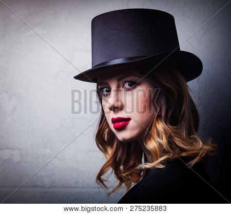 Style And Mystique Redhead Girl In Top Hat On Grey Background