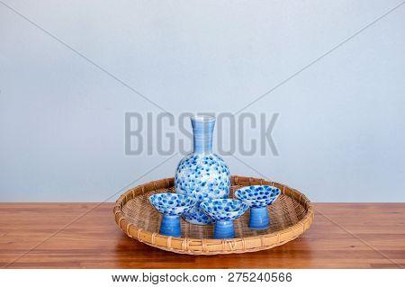 Close Up Of Japanese Sake Drinking Set On A White Background.