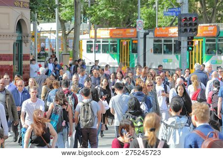Melbourne Australia - December 3, 2018: Unidentified People Cross Street In Downtown Melbourne Austr