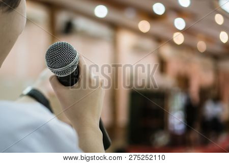Seminar Conference Concept: Rear Side Of Smart Businesswoman Speech And Speaking With Microphone Tal