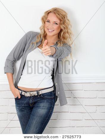 Beautiful blond woman showing thumb up