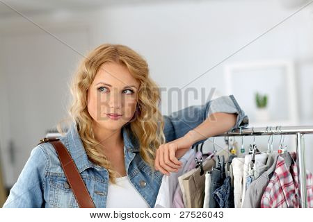 Woman standing in garment store