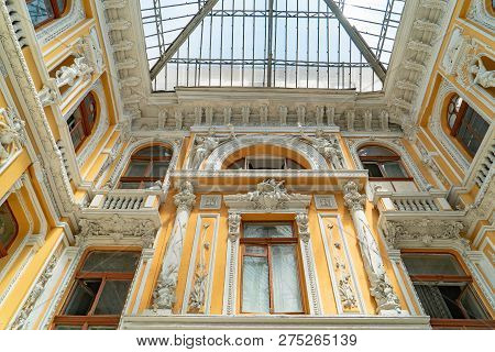 Modernist style architecture. Facade of the historic old building with sculptures and frescoes. poster