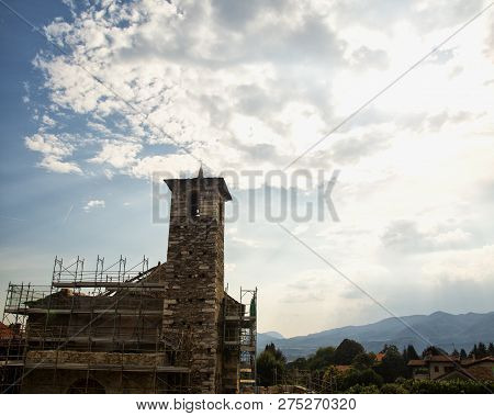 Church In Building Under Cloudy Sky