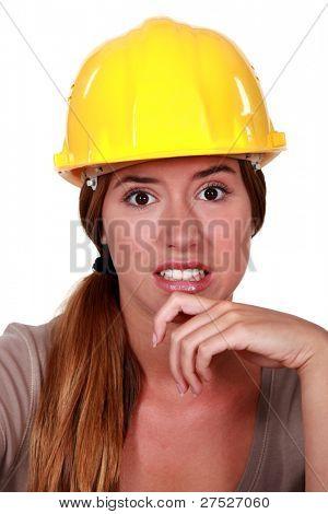woman wearing helmet looking disgusted