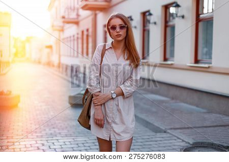 Beautiful Attractive Young Woman In Stylish Sunglasses In A Stylish Dress With A Fashionable Brown H