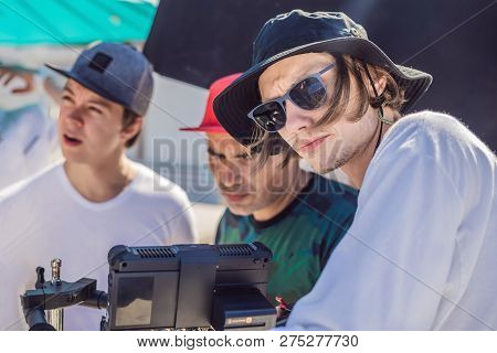 Camera Operator, Director Of Photography And Director Discuss The Process Of A Commercial Video Shoo