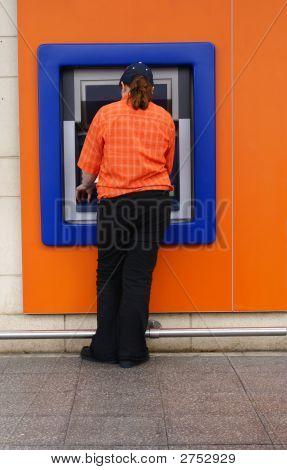 Young Woman Using Cash Machine