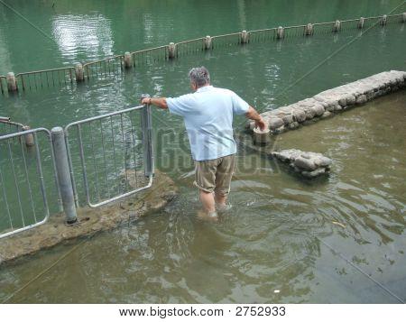 Man Paddling In The Water Of The Jordan River