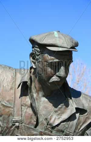 Close up of a statue of a man. poster