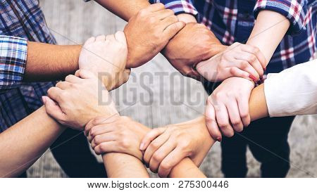 Close Up Hand Of Business Partnerships People Crossed Hands  Finishing Up Meeting Showing Unity Over