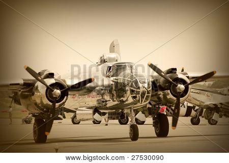 A wide vintage aeroplane in sepia color tone