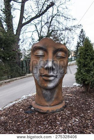 Bolkow, Poland, 6 December 2018: Monument Of The Face Next To The Pavement Near The Entrance To The