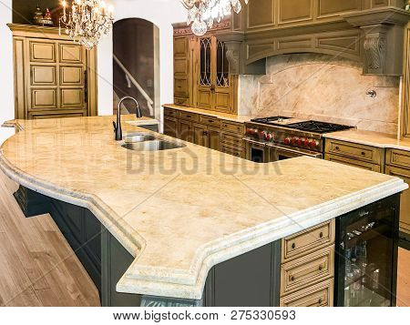 Beautiful kitchen with traditional design. dark kitchen island white kitchen with island countertop, under mount sink and stainless still appliances, very expensive kitchen cabinets, kitchen interior design, shaker wood kitchen cabinet design