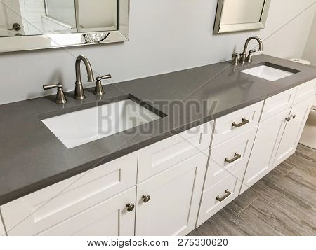 quartz stone, quartz countertop, bathroom vanity with quartz countertop, white cabinets under quartz countertops, white sink under quartz counter. new counter quartz installed.