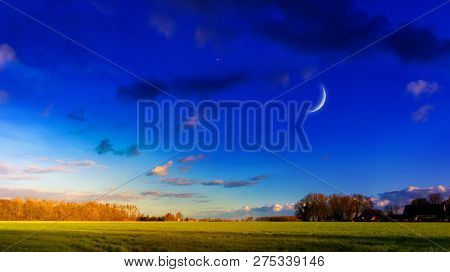 Crescent Moon With Beautiful Sunset Background . Generous Ramadan  . Moon Sun And Stars .  Light In