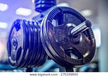 Black Steel Burbell Disks In The Gym, Gym Equipment Concept. Close-up. Workout Training And Fitness
