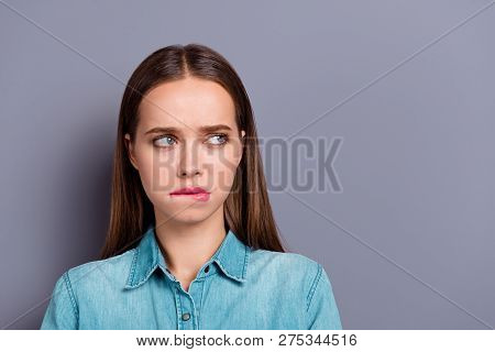 Close Up Portrait Of Sad Feeling Guilty Biting Lower Lip Pretty Woman Girl Wearing Denim Jeans Shirt