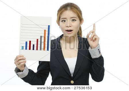 Successful attractive business woman Hold a finance chart graph