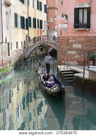 Venice/italy- April 16, 2018: An Unidentified  Caucasian Couple Having A Romantic Ride In Gondola.