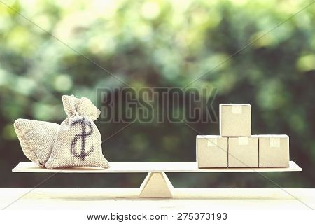 Money And Supply Concept : Money Dollar Bag And Supply Products On Balance Scale On Wooden Table Dep