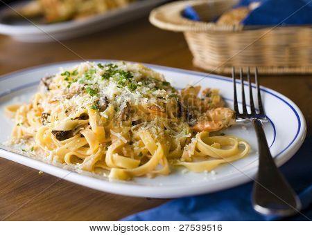tagliatelle frutti di mare - pasta with seafood and grated cheese