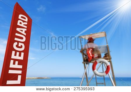 Lifeguard Station With A Red Signboard, Surveillance Tower, Lifebuoy, Sky And Sun Rays