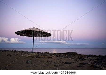 Lanzarote beach, straw sunshade in moonlight