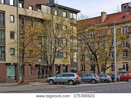 Residential Buildings And Cars. European Architecture. City Life. Construction Industry And Developm