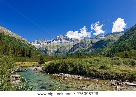 Peak Of Care Alto (3462 M) And River Chiese In The National Park Of Adamello Brenta Seen From The Va