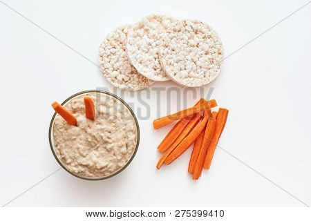 Hummus With Carrot Sticks. Top View Of Humus With Carrot Isolated On White Background.