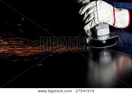closeup of grinding weld process, lots of sparks