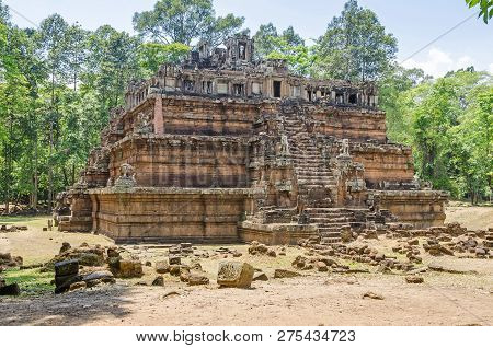 Phimeanakas or Vimeanakas, means celestial temple, a Hindu temple in the shape of a three tier pyramid located inside the walled enclosure of the Royal Palace of Angkor Thom at Angkor, Cambodia. poster