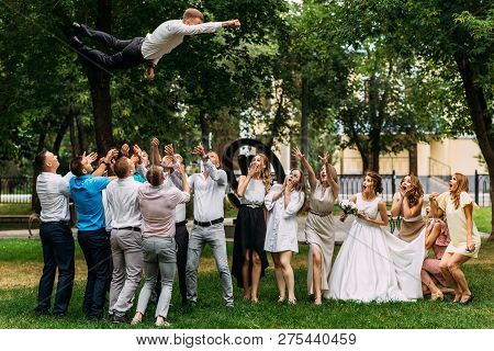 Russia, Orenburg -july 21, 2018: Bride And Groom Kissing At Wedding Ceremony. Funny Guests At The We