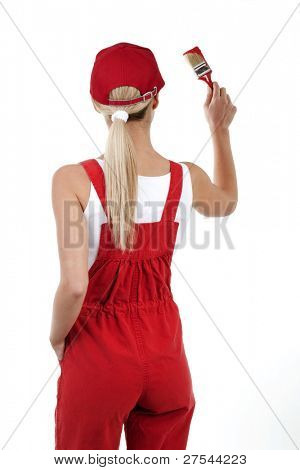 Rear view of a young woman painting; copy space for your own red painting
