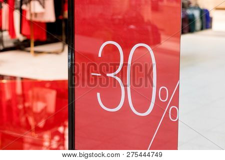 Sale. Shop Window With 30 Percent Discount. Winter Sale. Window Shop With Dressed Mannequin, Text Sa