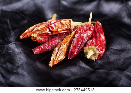 Dried Red Hot Peppers Over Black Background