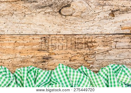 Old Wooden Table Surface With Rustic Green Checkered Cloth, Top View