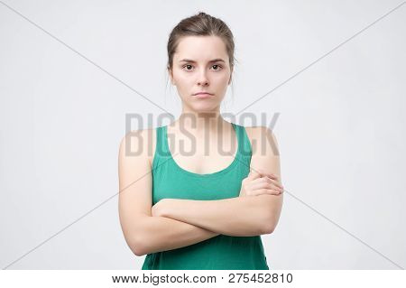 Aggravated Sad Woman Standing Crossed Hands Expressing Her Dissatisfaction And Disconent