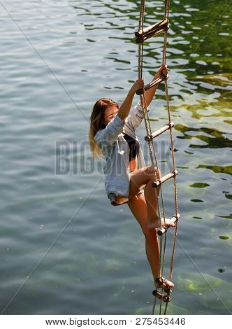 Ambition Can Move Mountains. Sexy Woman Climbing Up Rope Ladder. Pretty Woman Climb Jacobs Ladder To