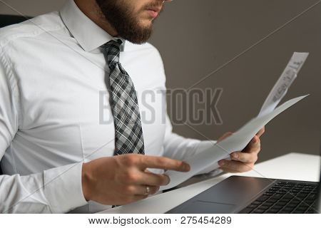 Young Bearded Businessman. Office Work With A Laptop. Financial Business. Businessman Work With Comp