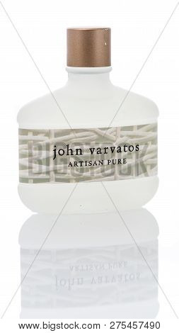 Winneconne, Wi - 10 December 2018:  A Bottle Of John Varvatos Artisan Pure Cologne On An Isolated Ba