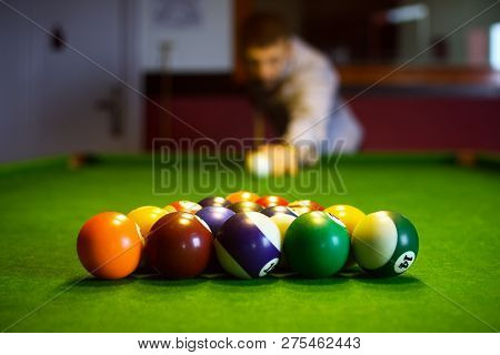 The Colorful Billiard Or Pool Balls For Snooker Game Are On Green Billiard Table For Starting The Ma