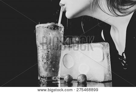 Party and summer vacation. Bar and restaurant, lemonade. Thirst and refresh. Cocktail with strawberry for young girl isolated on black. woman drink cocktail with ice cube. poster