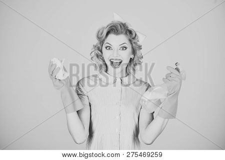 Pinup woman hold soup bottle, duster. Retro woman cleaner on grey background. Housekeeper in uniform with clean spray, duster. Cleanup, cleaning services, wife, gender. Cleaning, retro style, purity poster