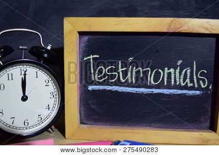 Testimonials On Phrase Colorful Handwritten On Blackboard. Education And Business Concept. Alarm Clo
