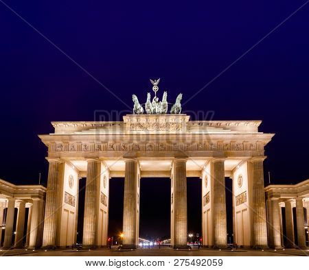 Illuminated Neoclassical Brandenburg Gate (Brandenburger Tor), one of the best known landmarks of Germany at night as viewed from the Pariser Platz, Mitte, Berlin, Germany