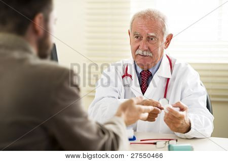Senior doctor with his patient