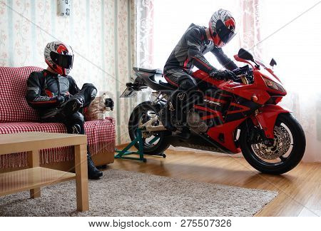 Krasnoyarsk, Russia - December 21, 2018: Beautiful Motorcyclist In Full Gear And Helmet On A Red And