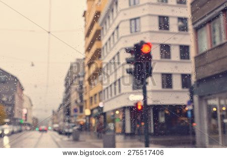 Matte Vintage. Rainy Evening In The City. Drive. Traffic Light. Overcast. Houses And A Road. Blurred